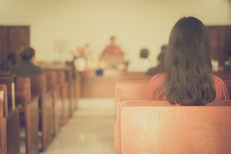 Back of woman's head in church
