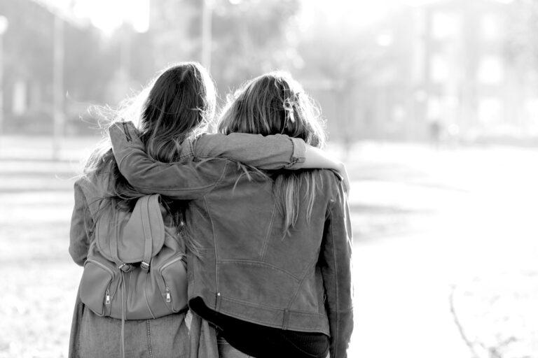 Two women walking down road