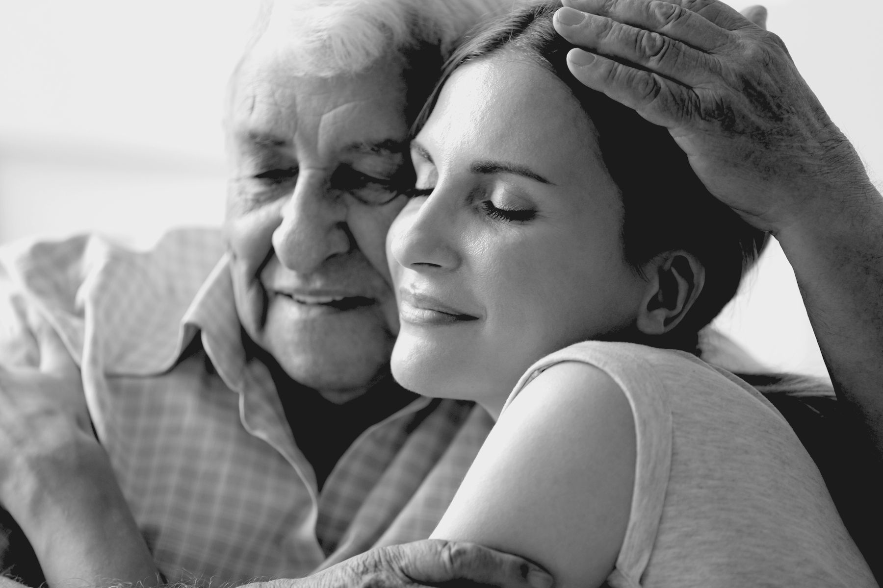 Grown daughter and father hug