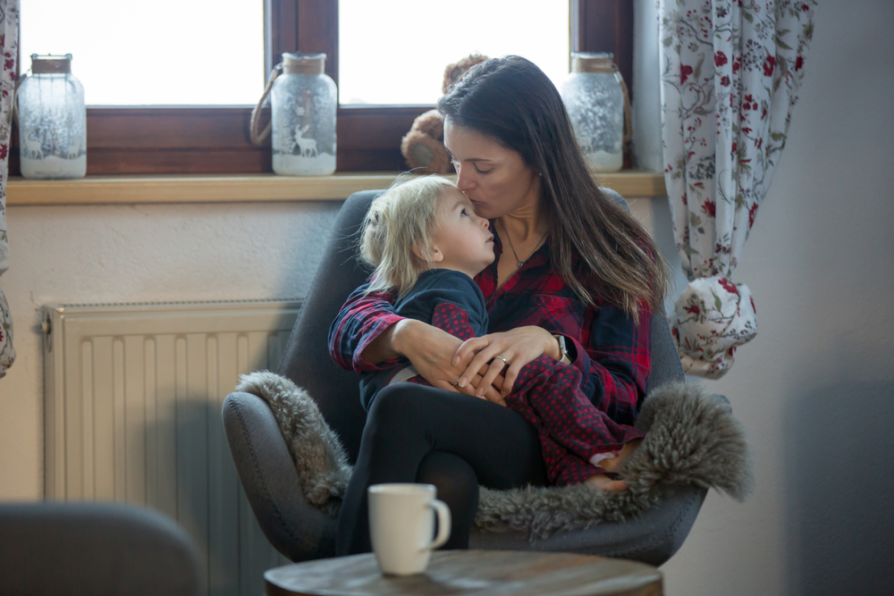 Mom sitting with toddler at home