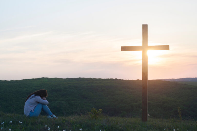 Woman at foot of cross
