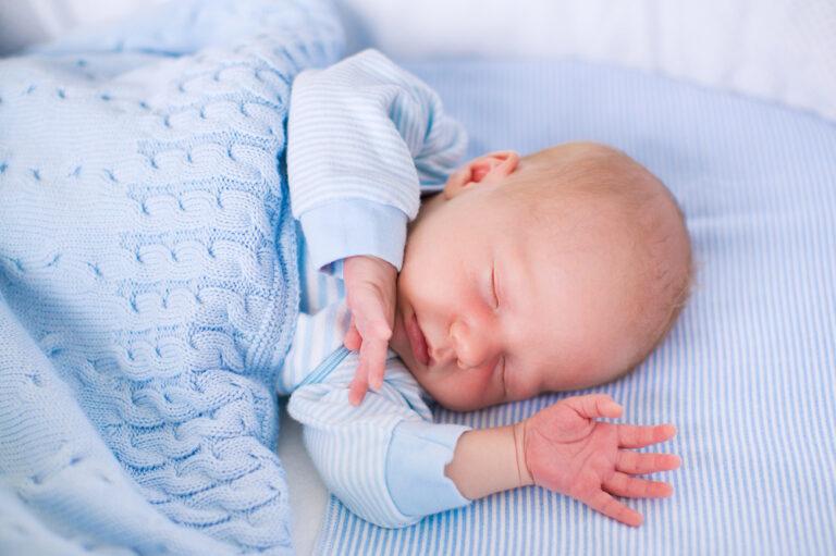 Baby in blue blanket asleep