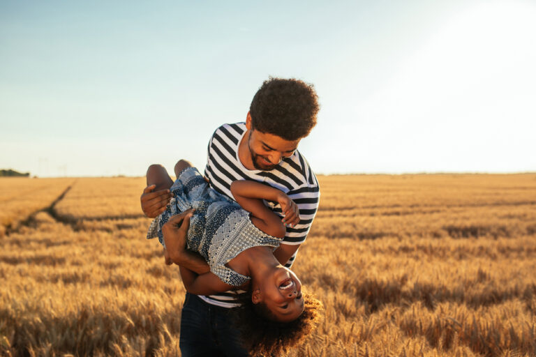 Man with child in field