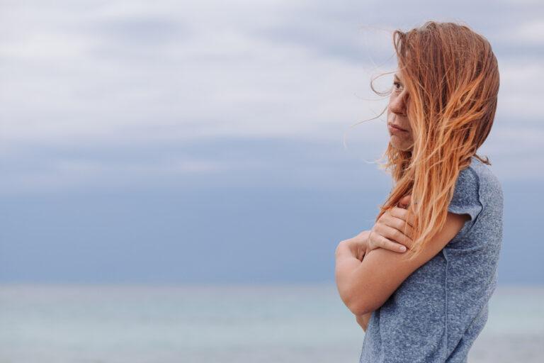 Sad woman by stormy sea