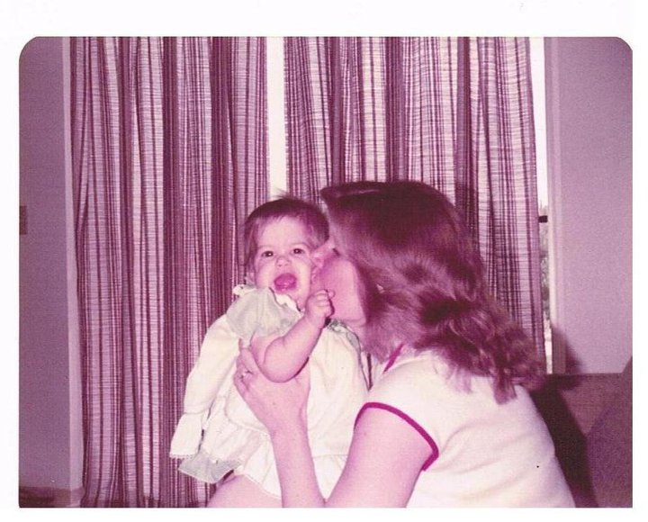 Mom kissing baby old photo