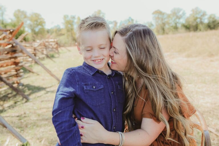 Mom with young son smiling