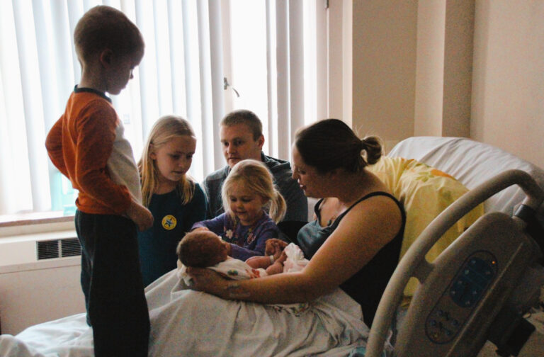 Family of six in delivery room