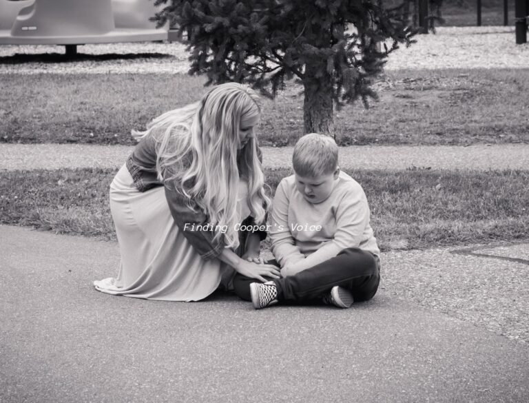 Mother kneeling by young boy