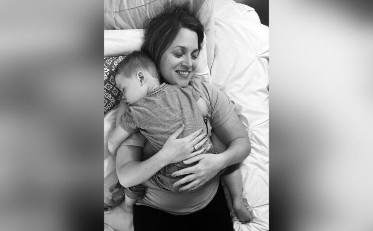 Mom hugging toddler