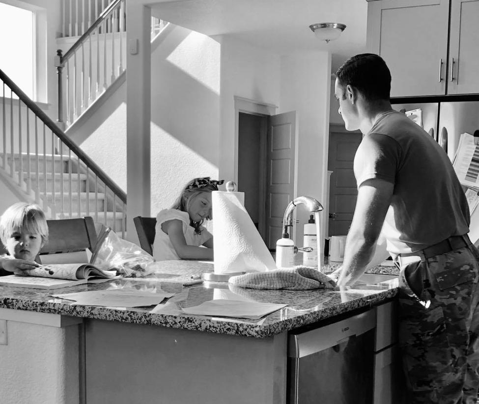 Dad standing at kitchen island