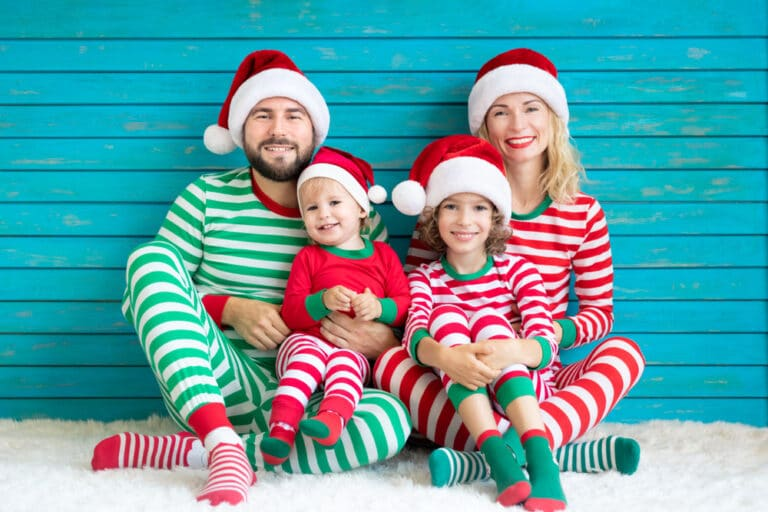 Family in matching Christmas pajamas