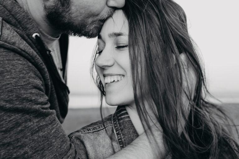 Husband kissing wife forehead