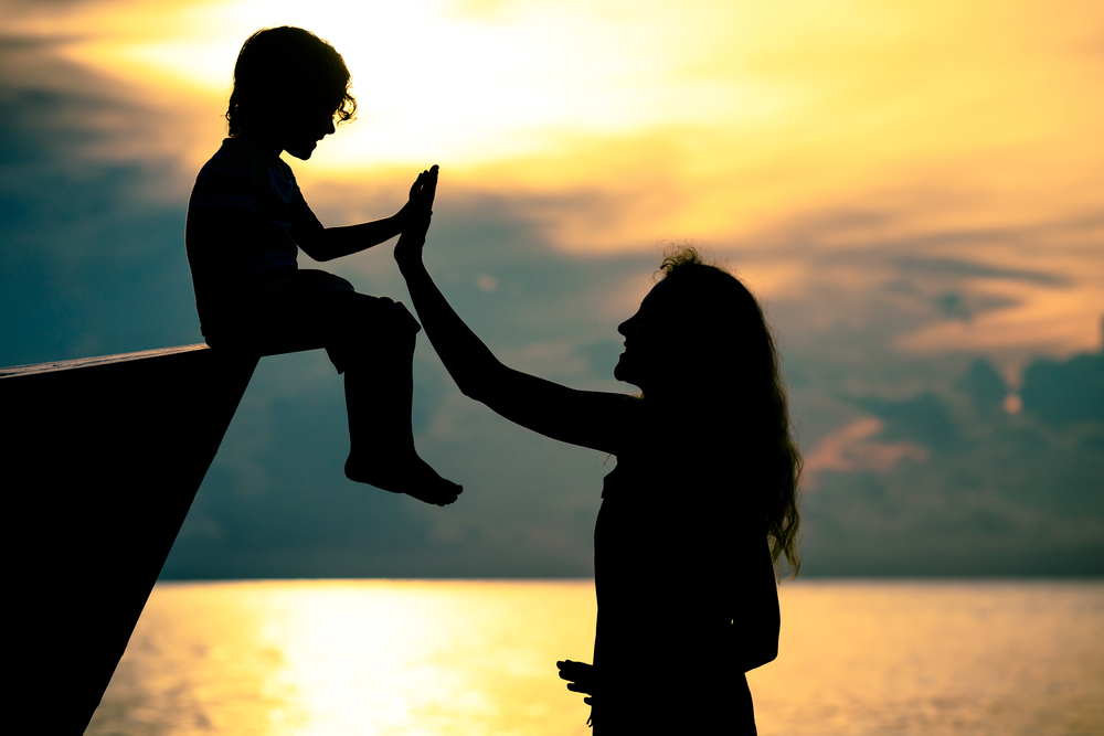 Mom high five child outside