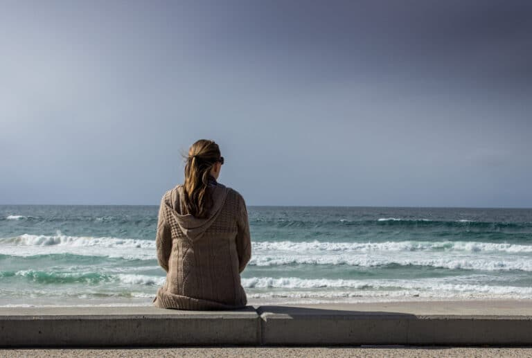woman staring out at sea