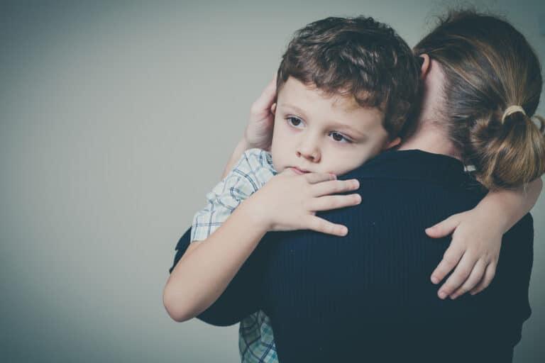 Mom hugging little boy