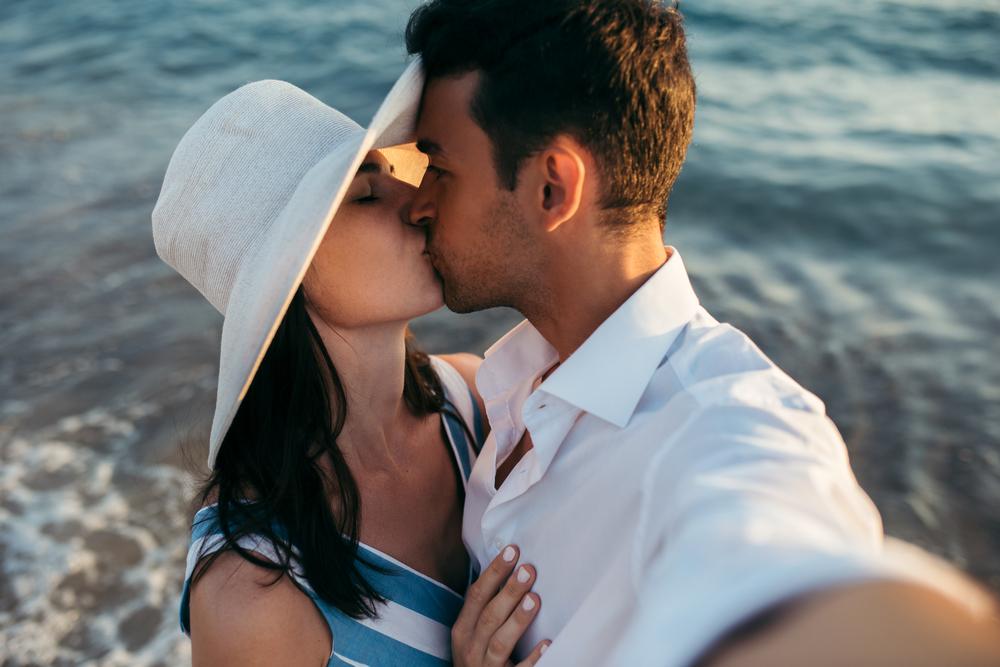 Man and women kiss in selfie