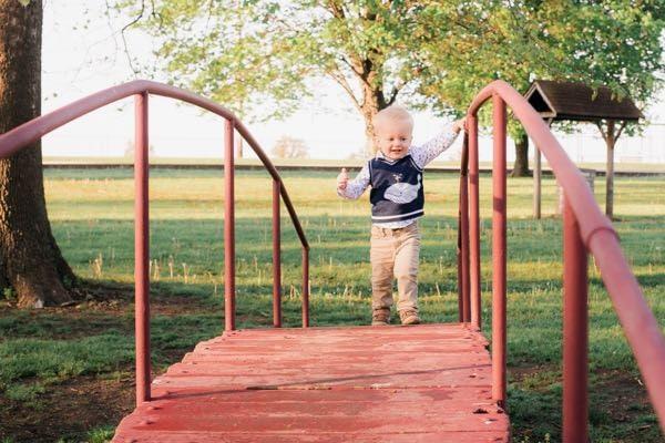Little boy on bridge