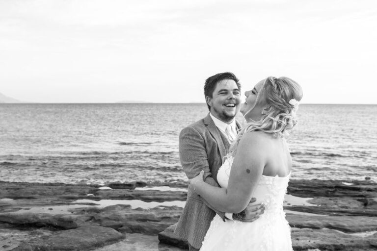 Bride and groom on the beach, black-and-white photo