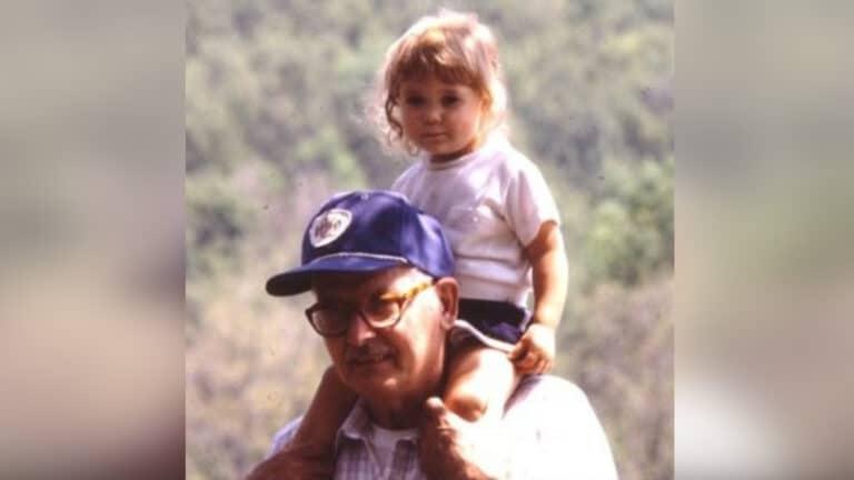 Little girl on Grandpa's shoulders