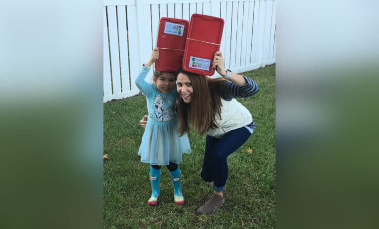 Mother and daughter with Christmas shoeboxes