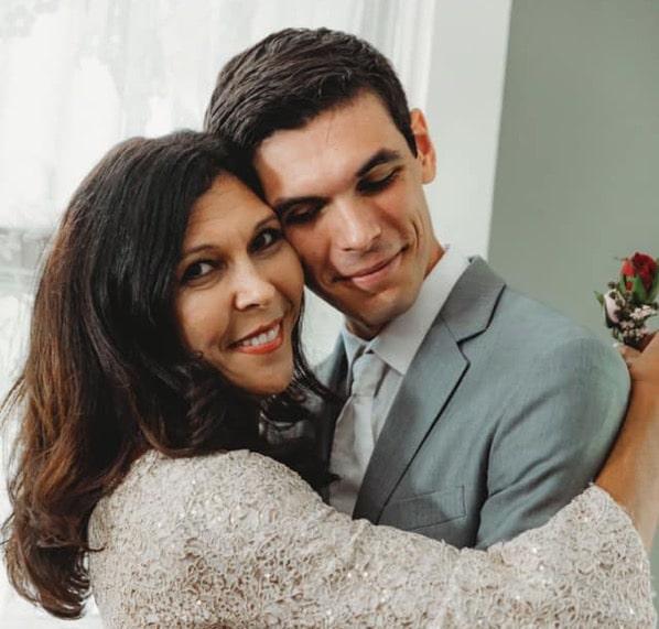 Mom and son hug