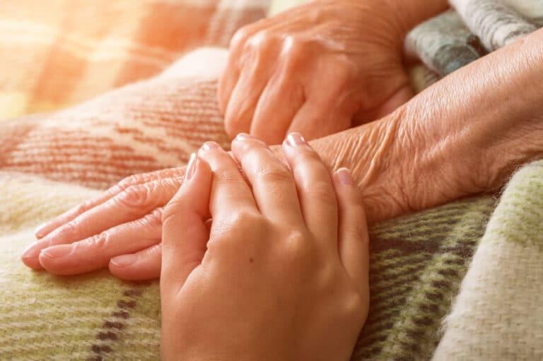 Holding elderly hand