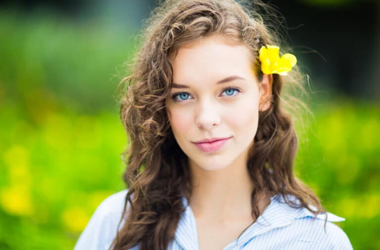 Teen girl with flower in hair