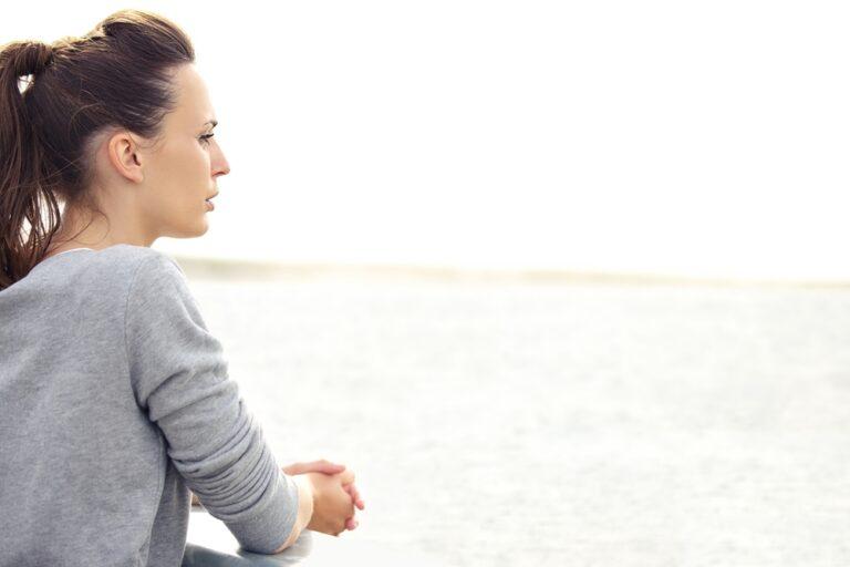 Woman looking at water