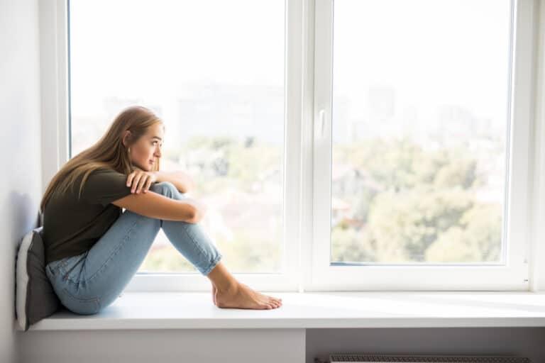 Woman sitting by window