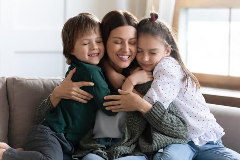 kids hug mom