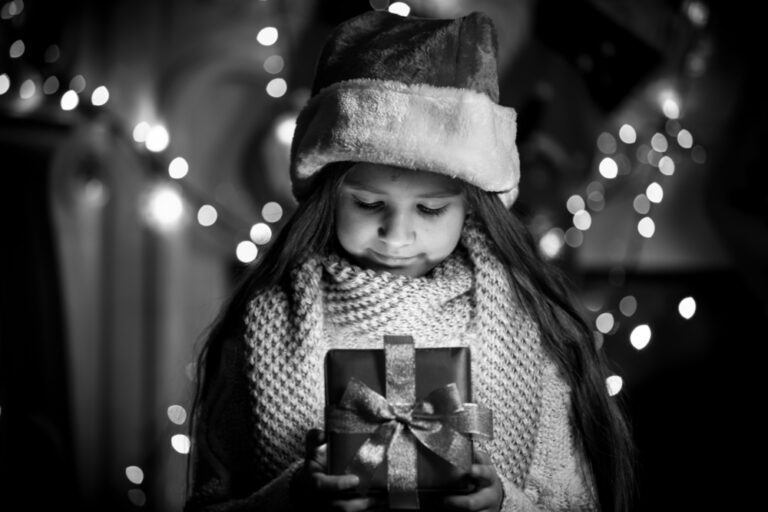 Little girl holding a Christmas gift