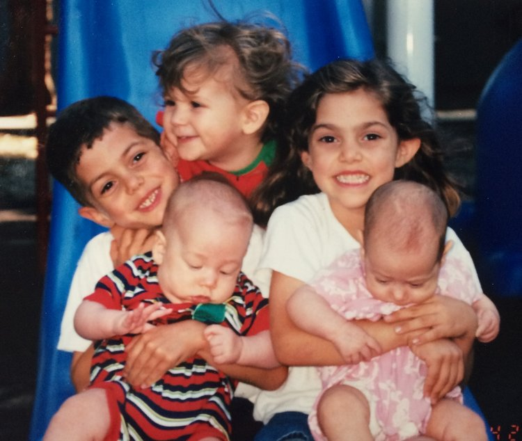 Old picture of five young children, color photo
