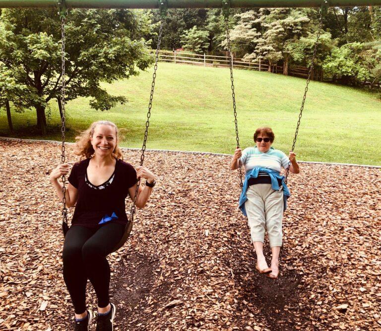 Grown women on swings, color photo