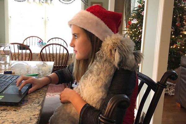 Teenage girl with her dog at Christmas