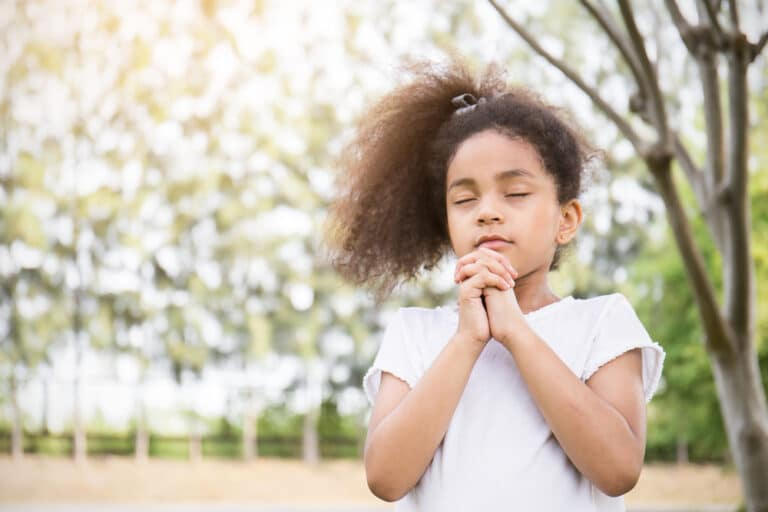 Child folded hands praying
