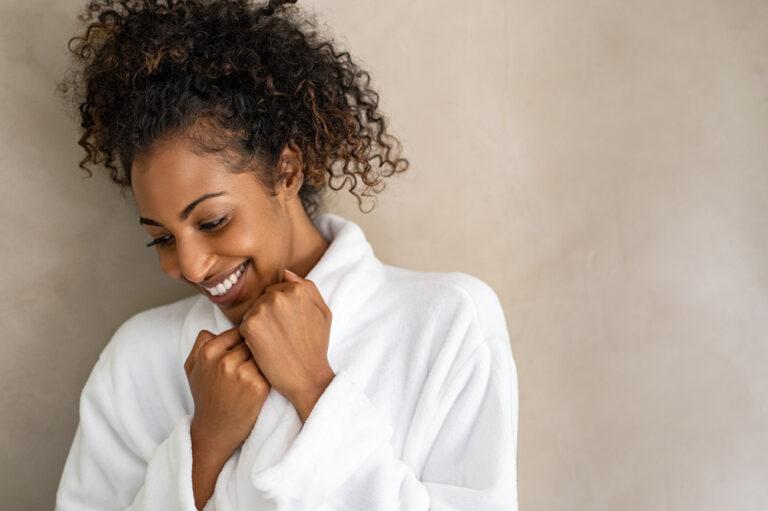 Woman smiling in bathrobe