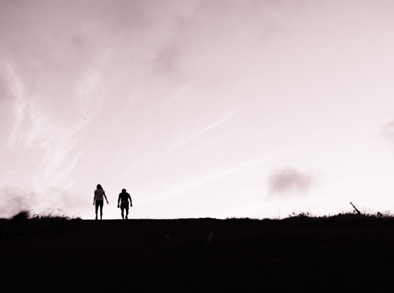 Two people walking in distance