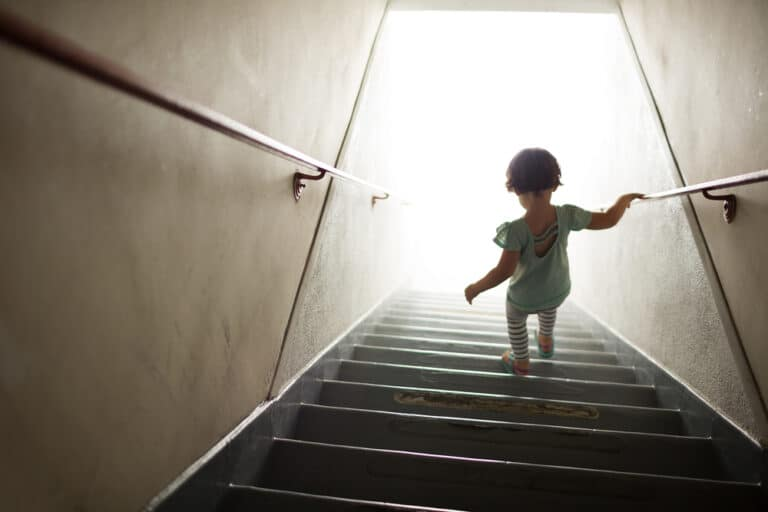 Little girl walking down stairs
