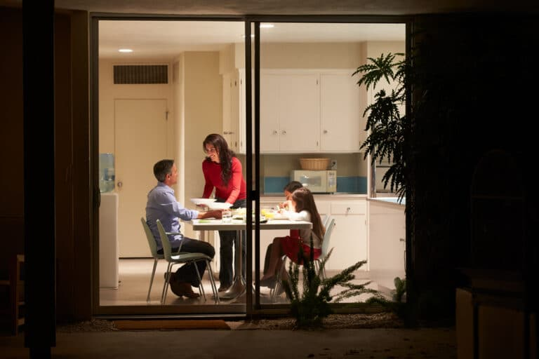 Family seen through window