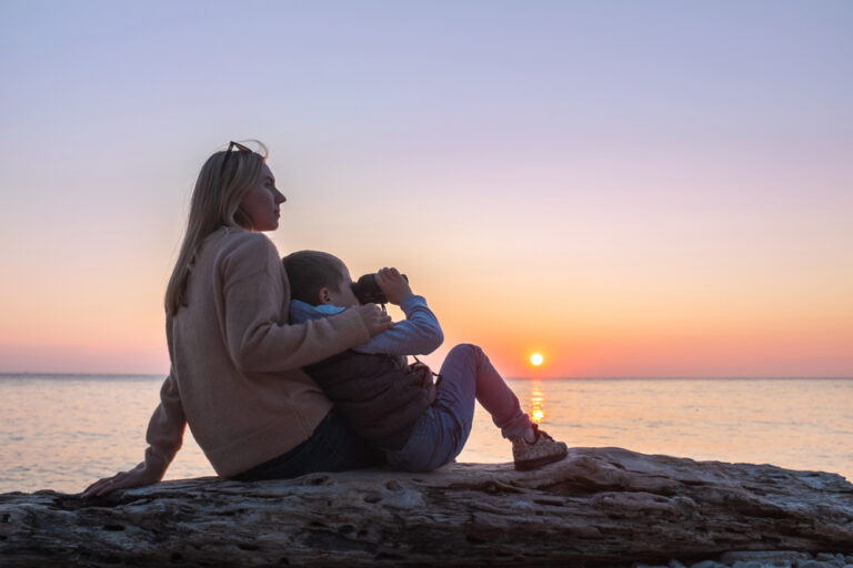 Mother and child watch sunset