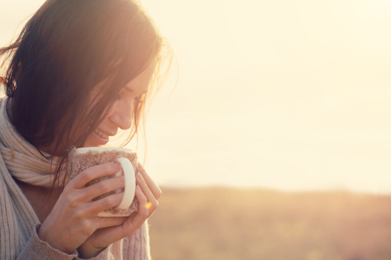 Woman with coffee outside