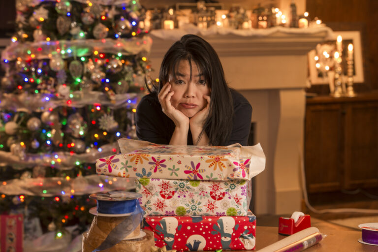 Woman tired wrapping presents