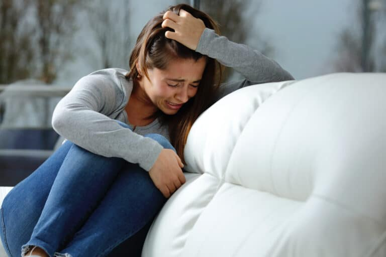 Crying teen on couch