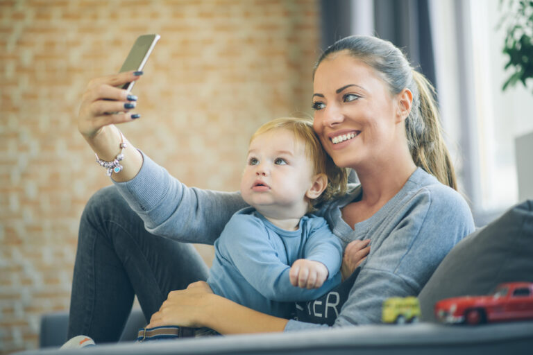 Mom taking selfie with child