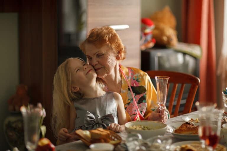 Elderly woman hugging granddaughter
