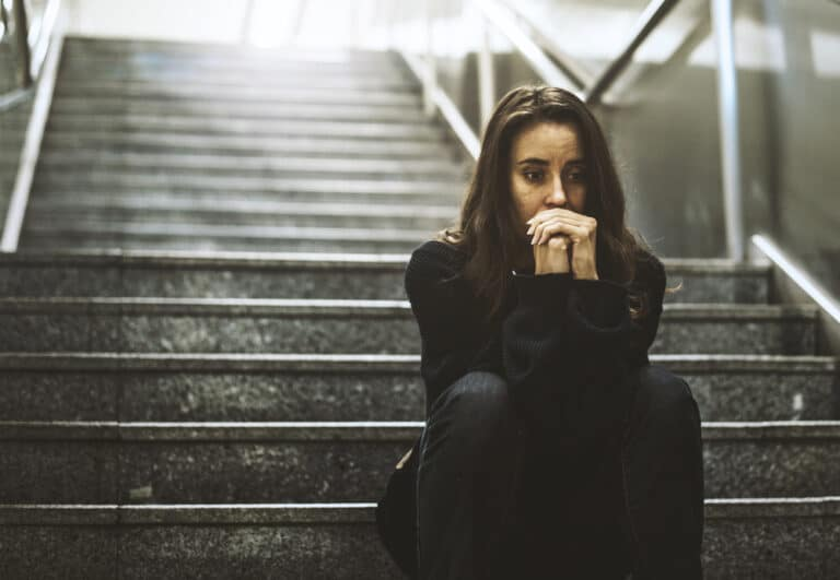 Sad woman on steps