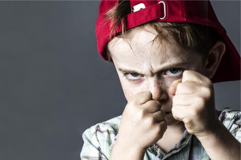 Angry child with fists up