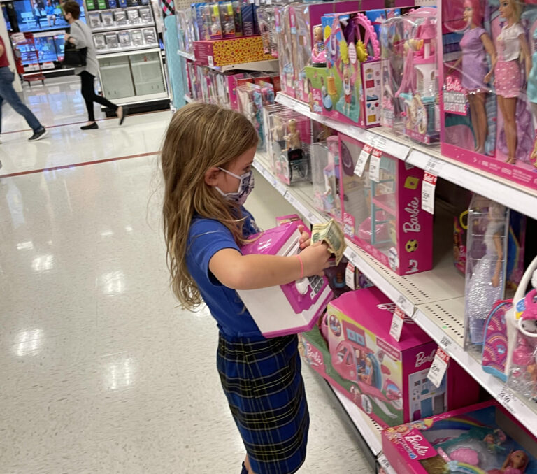 Little girl shopping for toys
