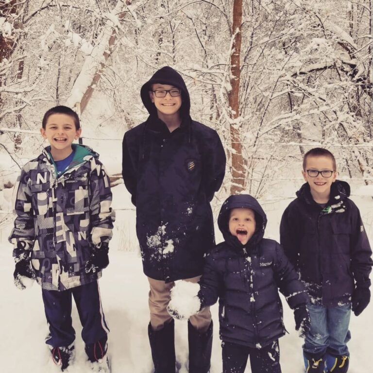 Four boys in snow