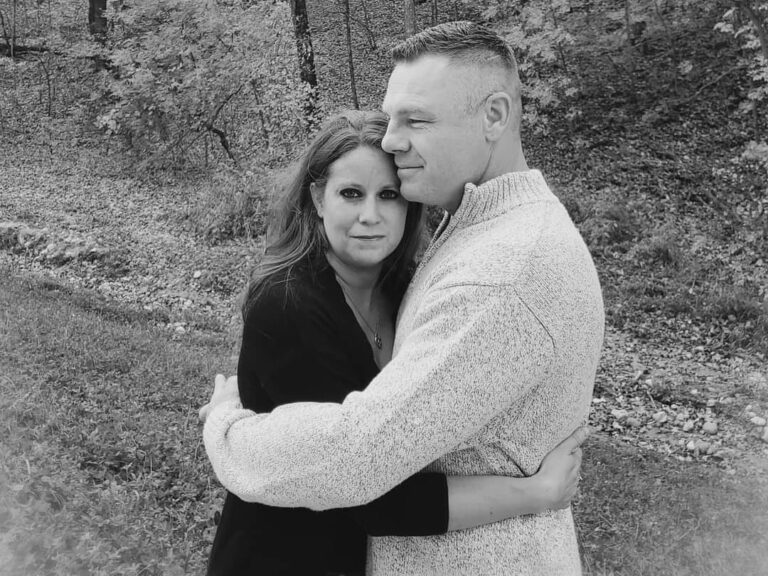 Husband and wife hugging, black-and-white photo